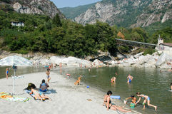 People swimming and sunbathing on maggia river at Ponte Brolla Royalty Free Stock Photos