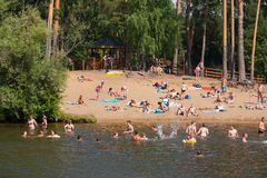 People swimming and sunbathing in Moskva river beach at Serebrya Stock Photo
