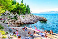 People swimming and sunbathing on the rocks in southern Croatia Royalty Free Stock Photos