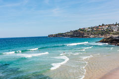 People swimming at Tamarama Beach in Sydney, Australia. People swimming at Tamarama Beach along the Bondi to Coogee coastal walk in Sydney, Australia. A cliff Stock Photos