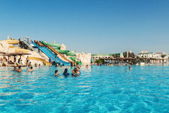 People swimming in the water park pool hotel in Hurghada. Egypt. Royalty Free Stock Images