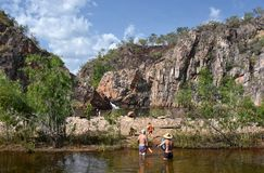 People swimming in the waterhole at Edith Falls. Which is a series of cascading waterfalls and pools on the Edith River in the Nitmiluk National Park stock image