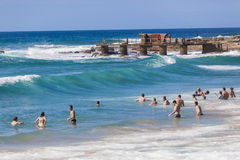 People Swimming Waves Stock Photography