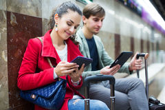 People with tablet at metro Stock Photo