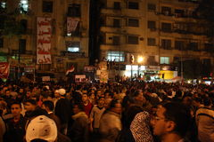 People In tahrir square during Egyptian revolution. People gathering In tahrir square in egypt during Egyptian revolution at night, rainy ground Royalty Free Stock Images