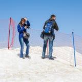 People on the Tahtali mountain. TAHTALI, TURKEY - APR 20, 2015: Unidentified tourist makes pictures on the top of the Tahtali mountain. Tahtali mountain is 2365m Stock Photos
