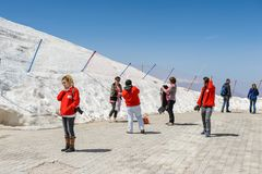People on the Tahtali mountain. TAHTALI, TURKEY - APR 20, 2015: Unidentified tourists on the top of the Tahtali mountain. Tahtali mountain is 2365m high Stock Image