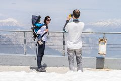 People on the Tahtali mountain. TAHTALI, TURKEY - APR 20, 2015: Unidentified tourists on the top of the Tahtali mountain. Tahtali mountain is 2365m high Royalty Free Stock Photos
