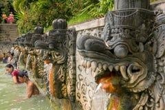 People take a bath in thermal Banjar Tega hot springs in Bali Royalty Free Stock Photos