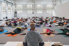 People take a class at Yoga Festival 2014 in Milan, Italy Stock Images
