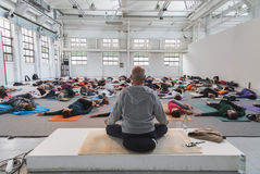 People take a class at Yoga Festival 2014 in Milan, Italy Royalty Free Stock Photography