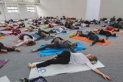 People take a class at Yoga Festival 2014 in Milan, Italy Stock Photo