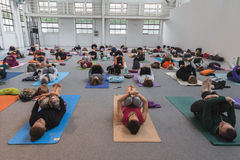 People take a class at Yoga Festival 2014 in Milan, Italy. MILAN, ITALY - OCTOBER 10: People take a class at Yoga Festival, event dedicated to yoga, meditation Stock Photos