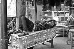 People take a day nap with a helmet. An interesting life style in Jakarta. A man with his helmet on, take a nap in the morning time Stock Images