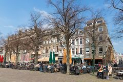 People take a drink at the terraces of The Hague,  Stock Photos