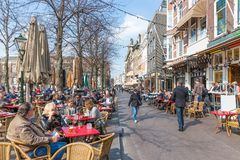 People take a drink at the terraces of Het Plein near the Dutch Government buildings of The Haque Stock Photos