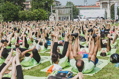 Almost 2000 people take a free collective yoga class in a city park in Milan, Italy Royalty Free Stock Image