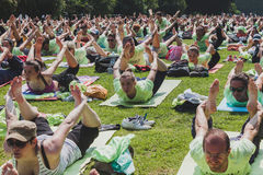 Almost 2000 people take a free collective yoga class in a city park in Milan, Italy Royalty Free Stock Photography
