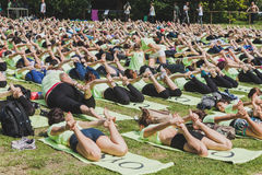 Almost 2000 people take a free collective yoga class in a city park in Milan, Italy Stock Photos