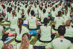 Almost 2000 people take a free collective yoga class in a city park in Milan, Italy Royalty Free Stock Images