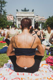 Almost 2000 people take a free collective yoga class in a city park in Milan, Italy Stock Photo