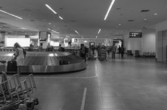 People take the luggages in Tan Son Nhat Airport, Saigon, Vietnam Stock Image
