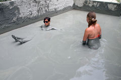 People take a mud bath with blue clay Royalty Free Stock Photo
