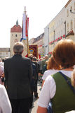 People take part in Corpus Christi procession. People taking  part in Corpus Christi Procession with banners of local Groups in Neuötting,Germany Royalty Free Stock Photos
