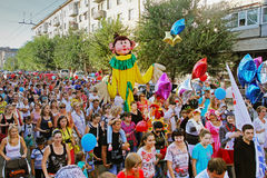 People take part in the parade of circus performers `Circus cavalcade` in Volgograd. Volgograd, Russia - August 26, 2014: People take part in the parade of Stock Images