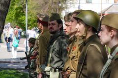 People take part in reconstruction of soviet military uniform at the Immortal regiment on 9 May, 2016 in Ulyanovsk, Russia stock photography