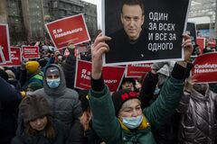 People take part in an unauthorized rally in support of Russian opposition leader Alexei Navalny