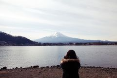 People take a photo of Mountain Fuji in Japan cover by snow,selecetive spot focus. royalty free stock photo