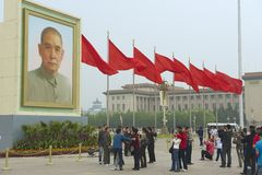 People take photos at Tiananmen Square in Beijing, China. Stock Photography