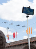 People take pictures of the helicopters on the Victory Parade Royalty Free Stock Image