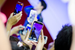 People take a pictures by Samsung during concert. Stock Photography