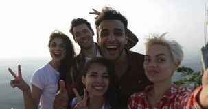 People Take Selfie Photo On Mountain Top At Sunrise, Mix Race Friends Group Send Blow Kisses Happy Smiling stock video