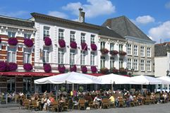 People take terrace at Grote Markt Bergen op Zoom Royalty Free Stock Image
