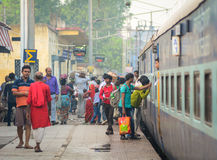 People take the train at station in Delhi, India Royalty Free Stock Images