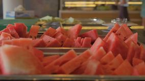 People take from the tray pieces of watermelon. Buffet in the hotel stock footage
