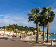 People take a walk on Promenade des Anglais in Nice Stock Photography
