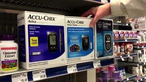 People taking Aviva nano diabetes care stock footage