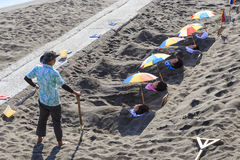 People taking a bath of hot sand in Kagoshima beach royalty free stock images
