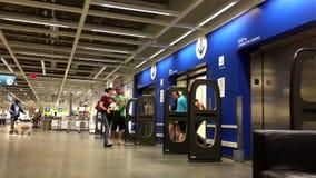 People taking elevator inside Ikea store stock video