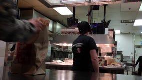 People taking food inside KFC chicken restaurant stock footage