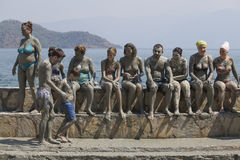 People are taking a mud bath. Mud baths are great for the skin. Dalyan, Turkey Royalty Free Stock Photography