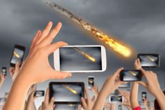 People taking photo of meteorite. Close up of human hands taking photo of falling meteorite royalty free stock photography