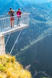 People taking photo at panoramic mountain viewpoint Eagle eye, Orlovo Oko in Rhodope Royalty Free Stock Photo