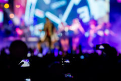 People taking photographs with touch smart phone during a music Stock Photos