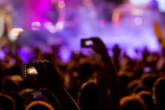 People taking photographs with touch smart phone during a music Royalty Free Stock Image