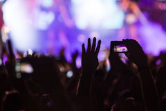 People taking photographs with touch smart phone during a music Stock Image